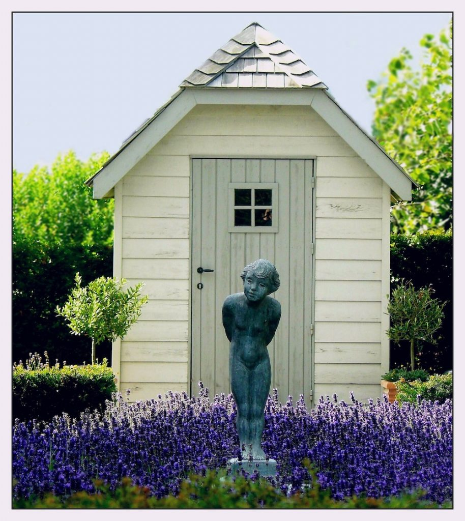 Minimize Your Lawn Mowing Garden Shed with Shrubs and Lavender #MinimizeLawn #ShrinkYourLawn #SmallerLawn #LessGrassLawn