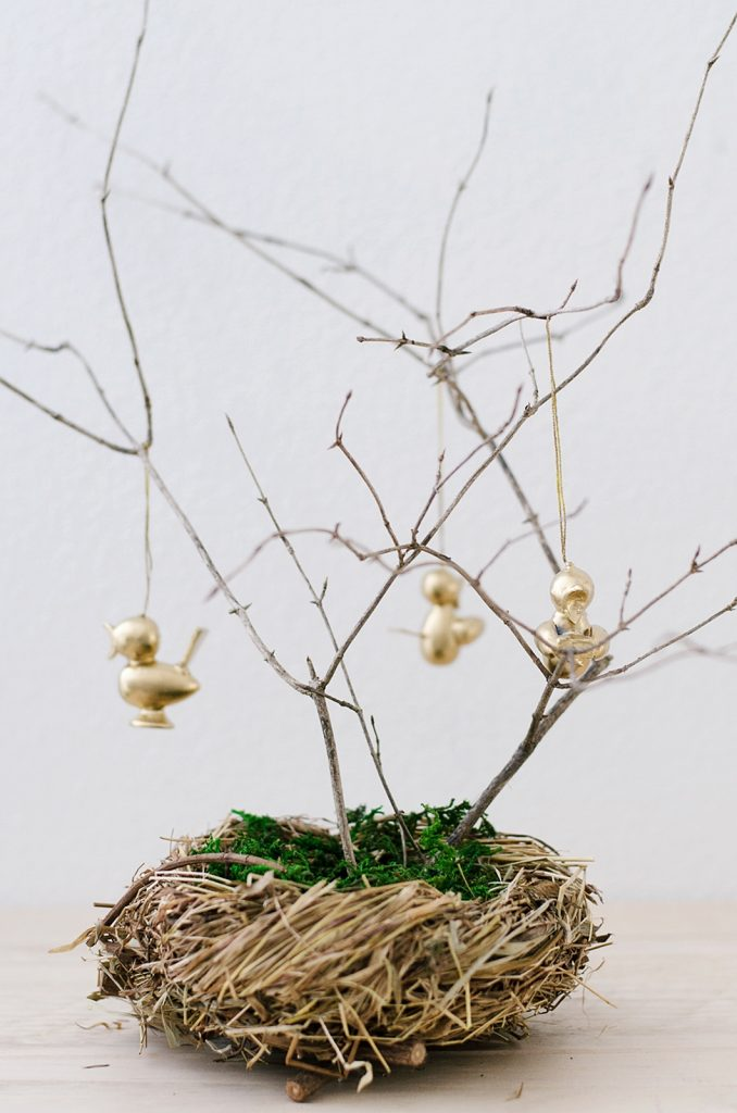 9 DIY Easter Decor Ideas for a Coastal Home - Easter Gold Chicks on Tree Branch #EasterDIY #EasterDecor #DIY #EasterCoastalDecor #EasterCoastalHome