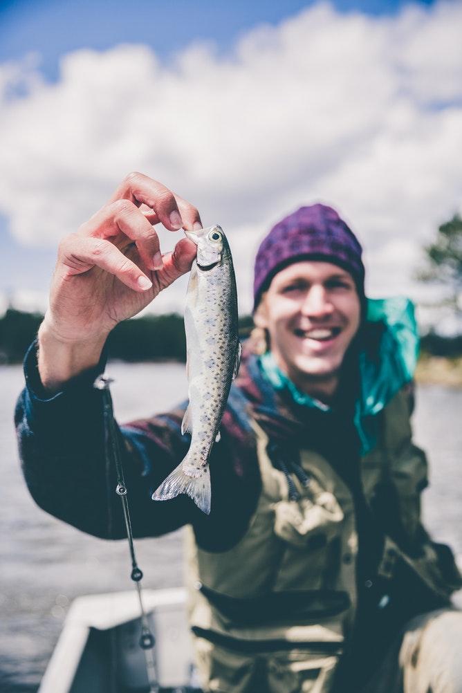 12 Budget Friendly Outdoor Summer Activities Fishing (photo Jakob Owens) #Fishing #OutdoorSummerActivities #SummerFun #LLBean #BudgetFriendly #OutdoorAdventures