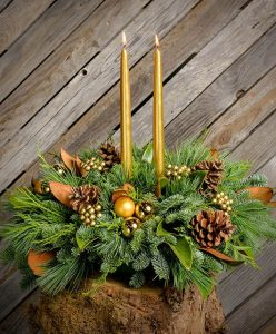 28 Christmas Centerpieces to Welcome House Guests Golden Magnolia Taper Candles #Gifts #Centerpiece #ChristmasCenterpiece #Christmas #Decor #ChristmasEvergreens