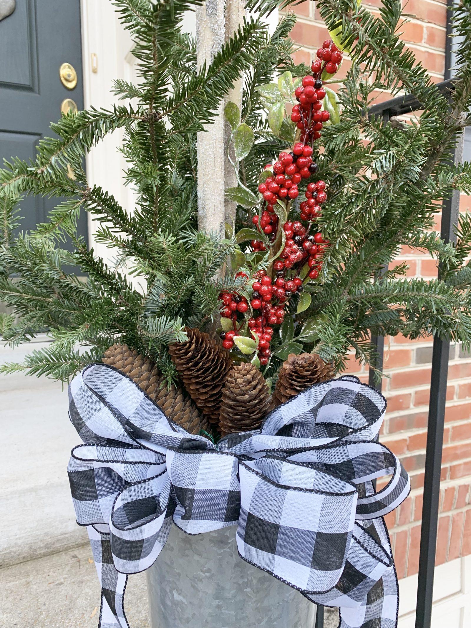 Modern Farmhouse Style DIY Christmas Door Decorations Christmas Birch Bucket #Farmhouse #Affordable #BudgetFriendly #Christmas #DIY #ChristmasDecor #FarmhouseDecor