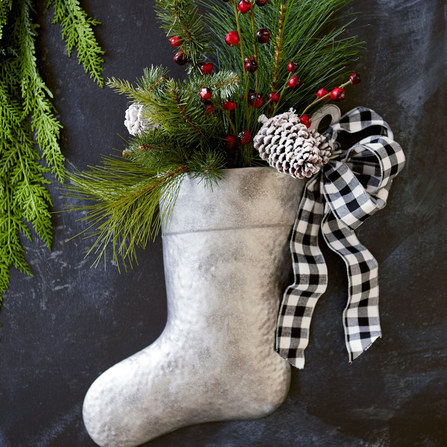 Modern Farmhouse Style DIY Christmas Door Decorations Galvanized Stocking Filled With Faux Greenery https://www.pier1.com/galvanized-stocking-%26-faux-greenery-door-hanger-%26-wreath-/3652349.html?cgid=wreaths-garlands#