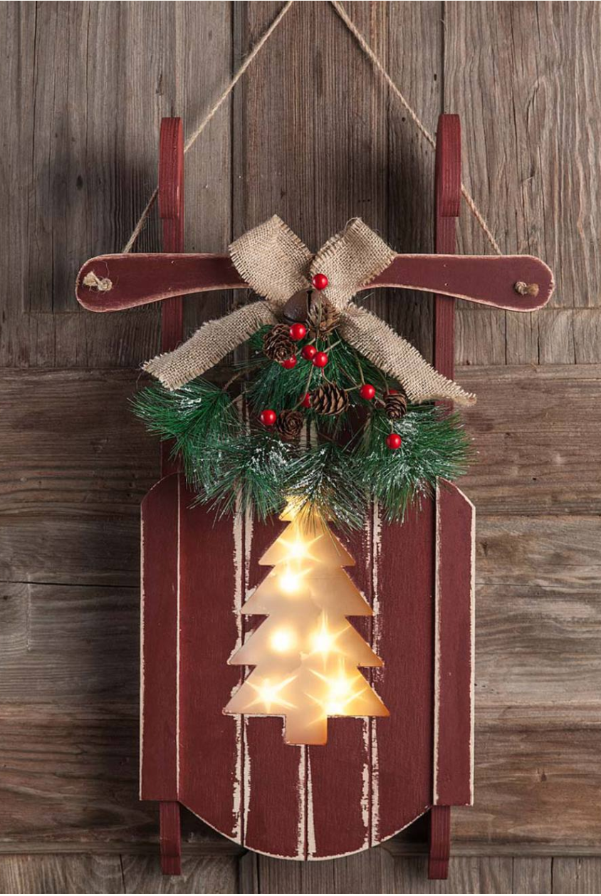 9 Christmas Front Door Decorations to Greet Your Holiday Guests Hanging Wooden Sled With Holiday Cutout Design #Christmas #ChristmasDecor #ChristmasSled #ChristmasGatherings #FamilyGatherings #FrontDoorDecor #PorchDecor