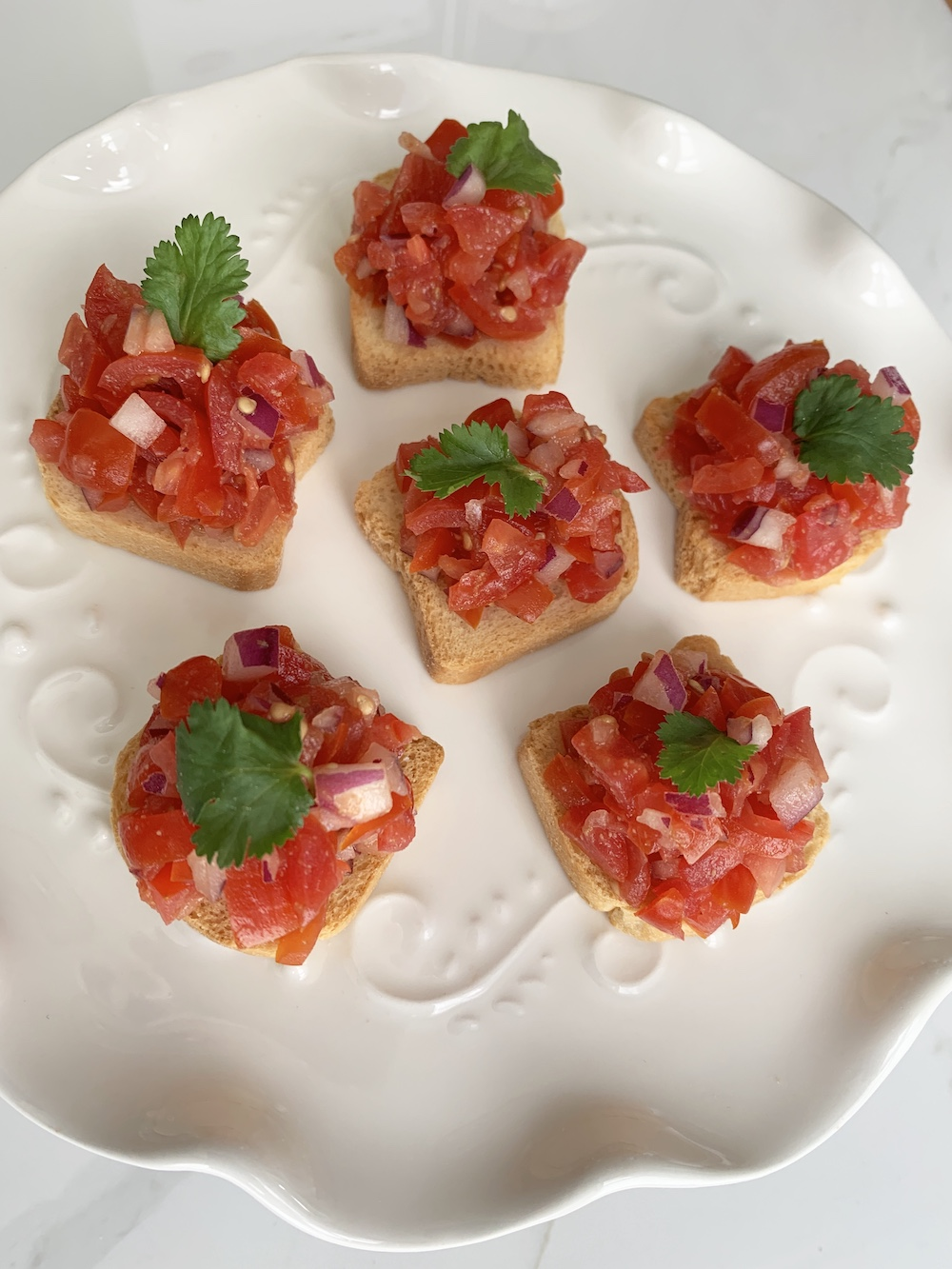 Grape Tomato Bruschetta, a Quick and Easy Appetizer Grape Tomato Bruschetta Fini #Bruschetta #GrapeTomatoes #TomatoBruschetta #QuickandEasy #BudgetFriendly #Affordable #Healthy #Appetizer #AffordableFood #SaveTime #SaveMoney