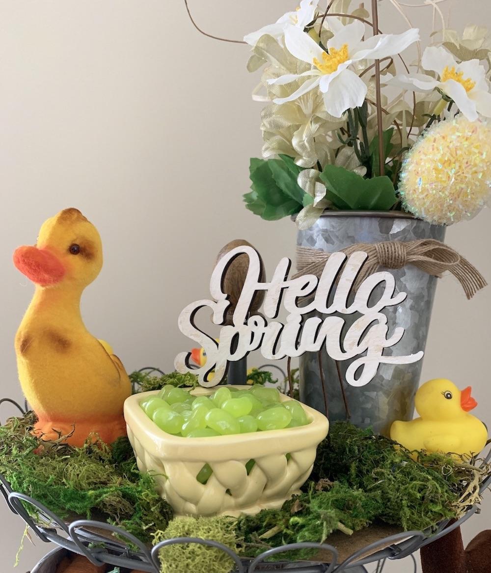 Hello Spring Farmhouse Stand Top Shelf #Farmhouse #DIY #Affordable #SimpleDecor #QuickAndEasy #BudgetFriendly #Spring #HelloSpring #SpringDecor #FarmhouseDecor