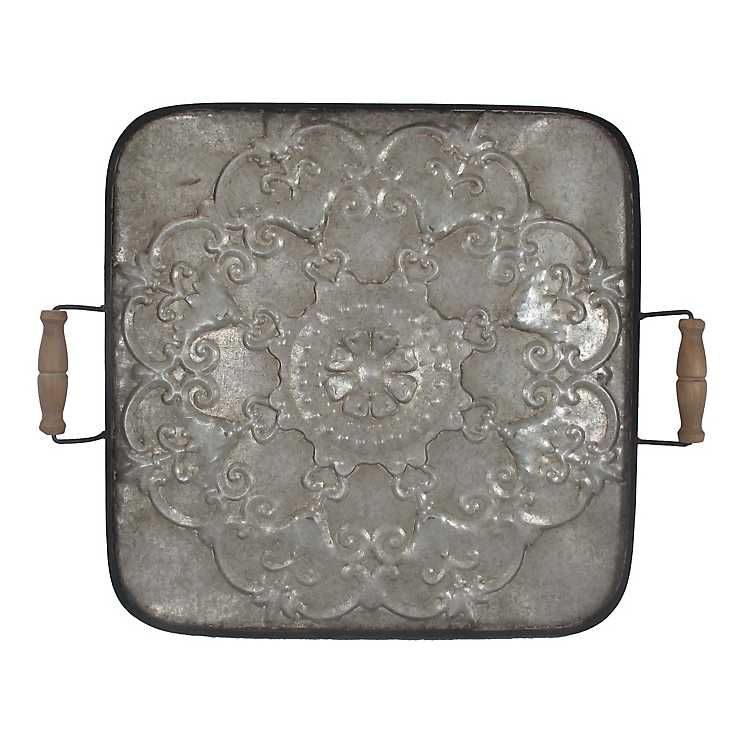 15 Farmhouse Trays for Every Budget Floral Embossed Galvanized Tray #Farmhouse #FarmhouseDecor #FarmhouseTrays #RusticDecor #Patio #OutdoorSpaces #OutdoorLiving #IndoorLiving #Entertaining