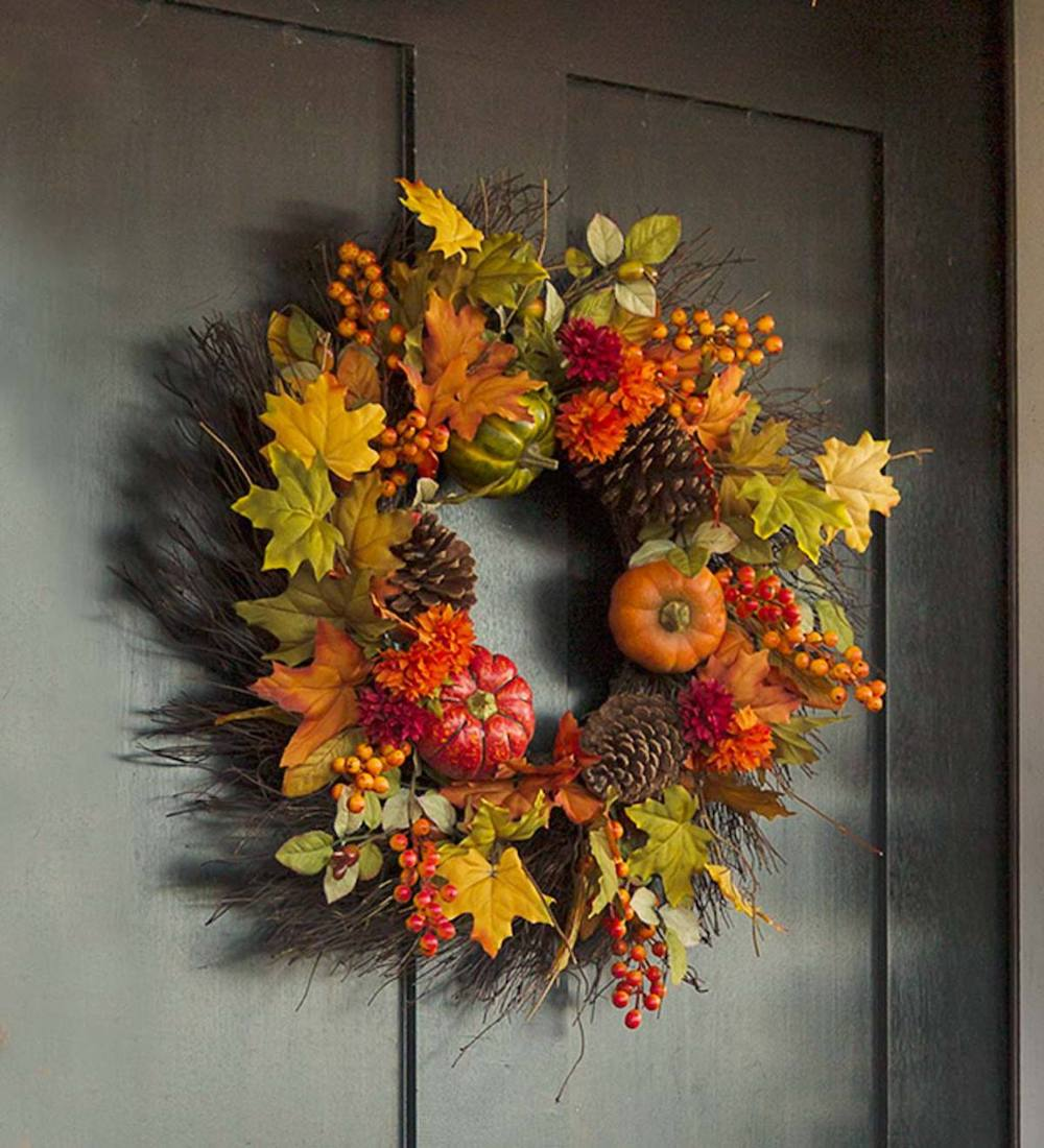 Farmhouse Fall Wreaths to Welcome Guests Pumpkin Pine Cones Fall Wreath #Farmhouse #FarmhouseDecor #FarmhouseWreaths #RusticWreaths #CountryLiving #FallWreaths #AutumnWreaths