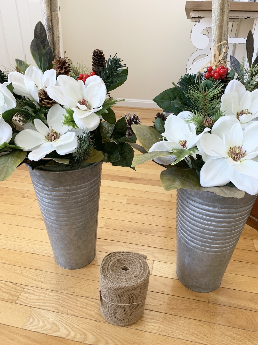 DIY Decor Floral Magnolia and Green Pine Mix in Buckets #DIY #DIYChristmasDecor #ChristmasDecor #ChristmasEntrywayDecor #DIYFrenchFloralBucketDecor #FrenchFloralBucketDecor #GalvanizedFloralBucketDecor #DecorTutorial