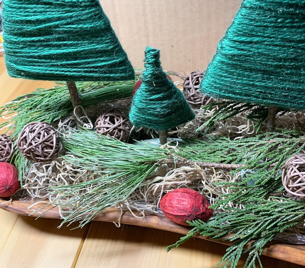 Affordable Home Decor Place Faux Red Pods and Brown Twig Balls #DIY #DIYChristmasCenterpiece #ChristmasDecor #ChristmasTableTop #DIYChristmasProject #RusticDecor #ChristmasCenterpiece