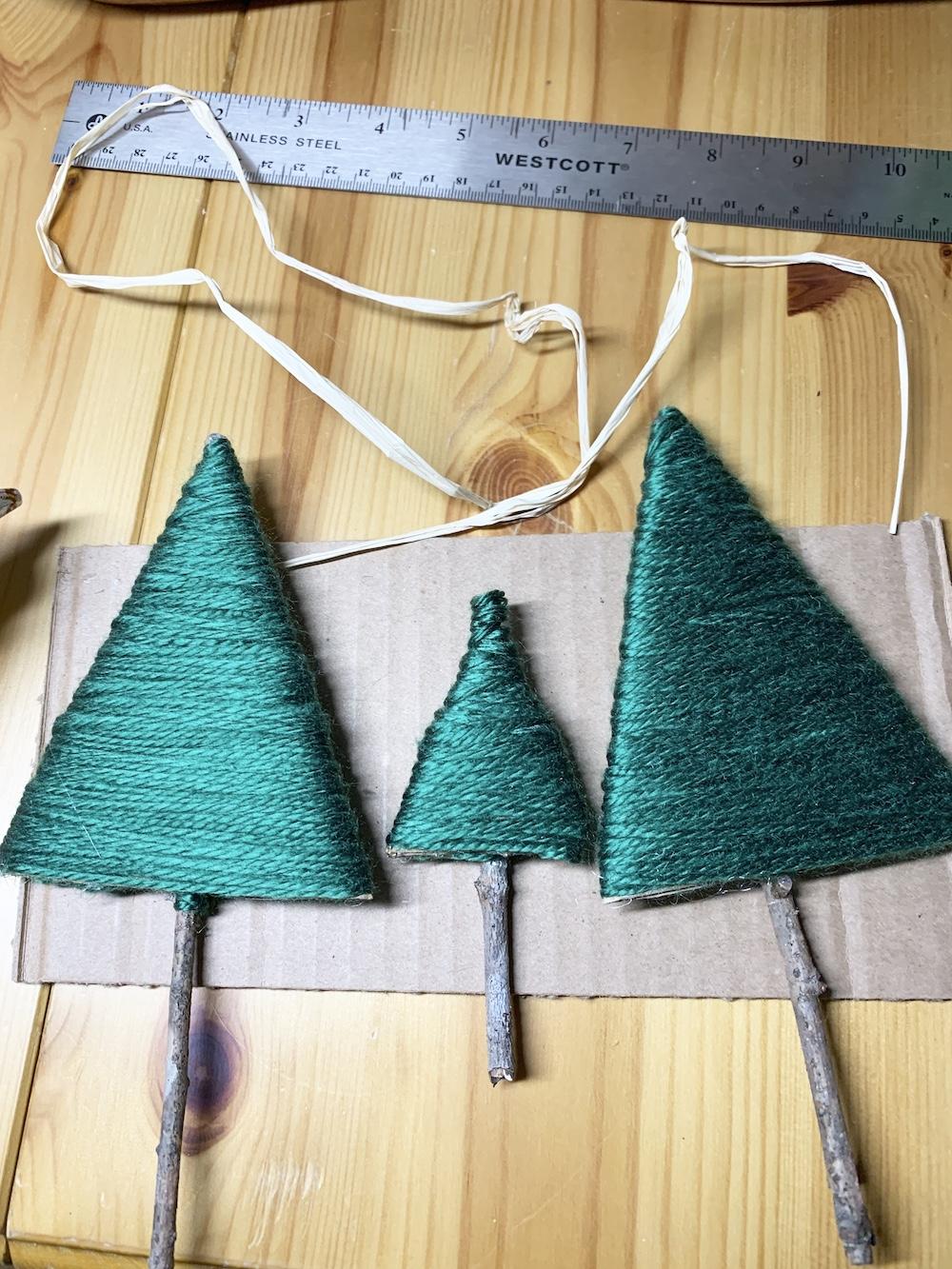 Easy DIY Decor Yarn Wrapped Trees #DIY #DIYChristmasTree #ChristmasDecor #ChristmasTableTop #DIYChristmasProject #RusticDecor