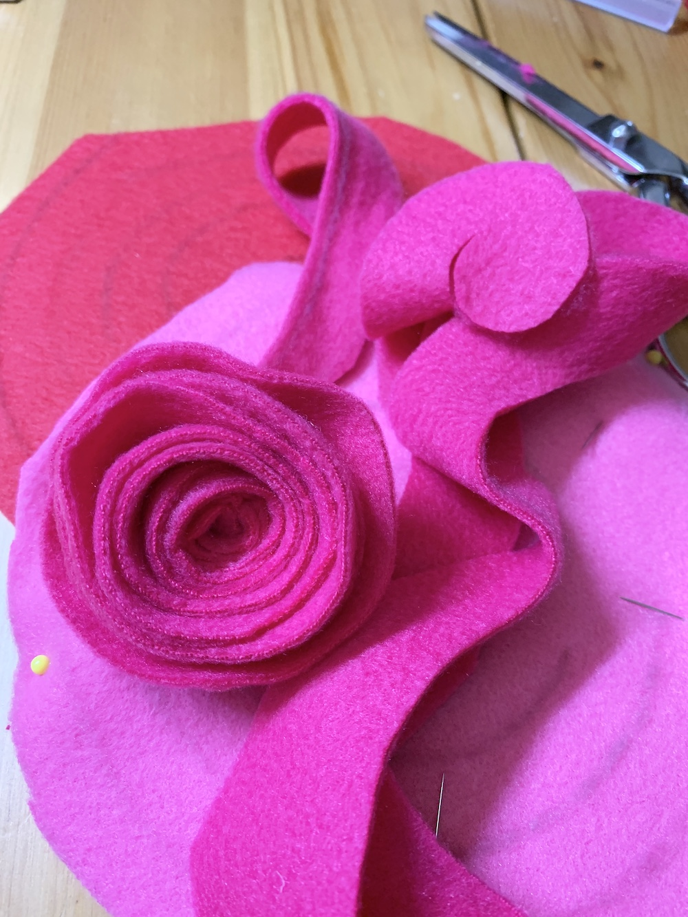 DIY Decor Roll Swirls to Create the Rosettes #ValentinesDay #ValentineHeart #DIY #Decor #DIYDecor #DIYValentineDecor