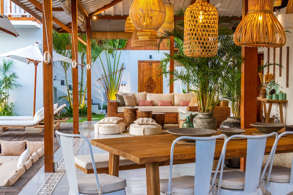 12 Ways to Add Coastal Decor to Your Home Covered Outdoor Patio with Rattan Pendant Lighting #Coastal #CoastalDecorTips #BeachHouse #BeachHome #LakeHouse #CoastalDecor #SeasideDecor #IslandDecor #TropicalIslandDecor