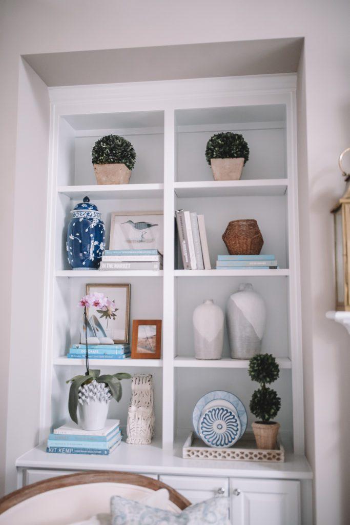 Coastal Bookshelf Decor Ideas Sandpiper Artwork #Coastal #CoastalDecor #Bookshelves #ShelfDecor #BeachHouse #BeachHome #LakeHouse #CoastalDecor #SeasideDecor #IslandDecor #TropicalIslandDecor