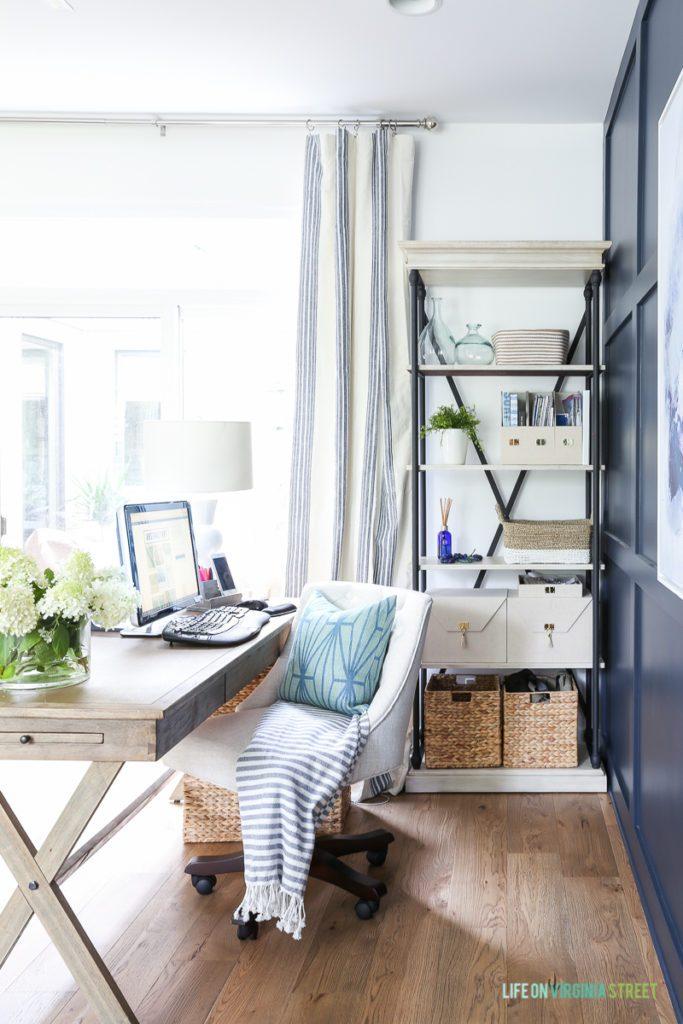 Coastal Bookshelf Decor Ideas Cream Colored Storage Bins #Coastal #CoastalDecor #Bookshelves #ShelfDecor #BeachHouse #BeachHome #LakeHouse #CoastalDecor #SeasideDecor #IslandDecor #TropicalIslandDecor