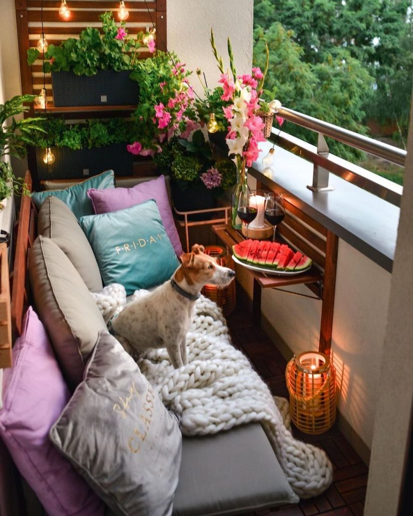 Add Layers of Pillows for Comfort #Balcony #BalconyDecor #BalconyDecorIdeas #CoastalBalcony #HomeDecor #AtHomeontheBalcony #HomeDecorTips #BalconyHome