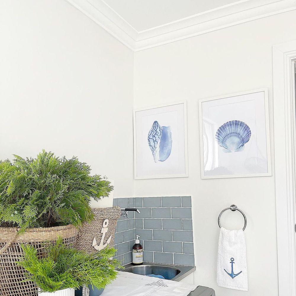 Art in the Laundry Room #Art #WallArt #WallArtIdeas #CoastalArt #CoastalWallArt #Entryway #HomeDecor #ConsoleTableDecor #LivingRoomArt #ArtFortheHome #HomeDecorTips #StylingTips