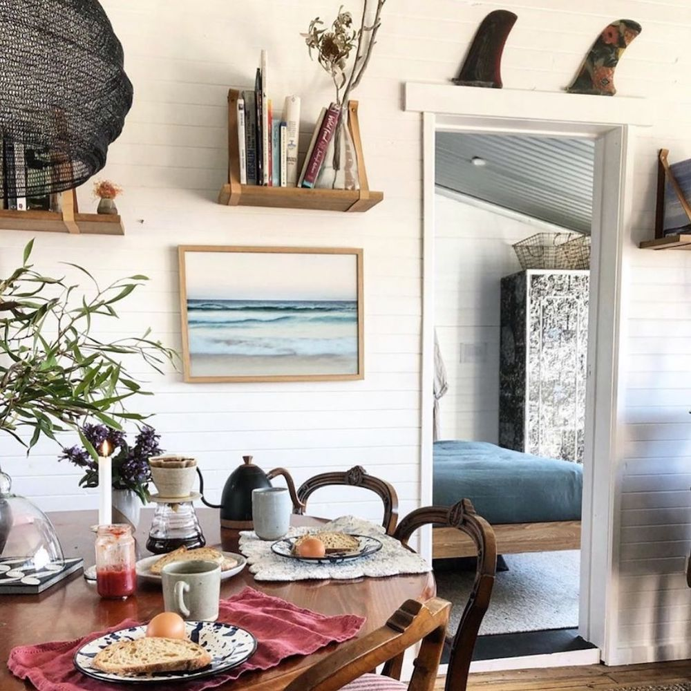 Display Artwork at the Breakfast Table #Art #WallArt #WallArtIdeas #CoastalArt #CoastalWallArt #Entryway #HomeDecor #ConsoleTableDecor #LivingRoomArt #ArtFortheHome #HomeDecorTips #StylingTips