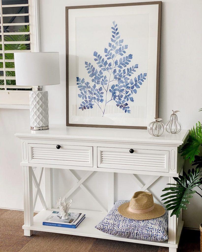 Display a Blue Wall Art Piece #Coastal #CoastalDecor #Entryway #Foyer #CoastalEntryway #CoastalFoyer #BeachHouse #BeachHome #SummerHouse #LakeHouse #ConsoleTable #SeasideDecor #IslandDecor #TropicalIslandDecor
