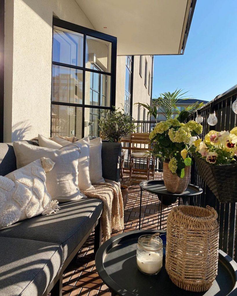 Lounge in the Morning Sun #Balcony #BalconyDecor #BalconyDecorIdeas #CoastalBalcony #HomeDecor #AtHomeontheBalcony #HomeDecorTips #BalconyHome
