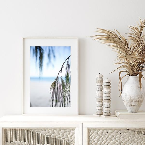 Coastal Wall Art Ideas Place Your Artwork on a Credenza #Art #WallArt #WallArtIdeas #CoastalArt #CoastalWallArt #Entryway #HomeDecor #ConsoleTableDecor #LivingRoomArt #ArtFortheHome #HomeDecorTips #StylingTips