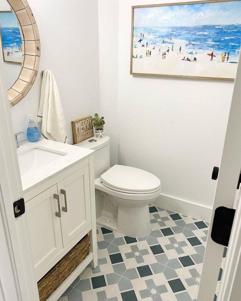 Show off your Artwork in the Bathroom #Art #WallArt #WallArtIdeas #CoastalArt #CoastalWallArt #Entryway #HomeDecor #ConsoleTableDecor #LivingRoomArt #ArtFortheHome #HomeDecorTips #StylingTips